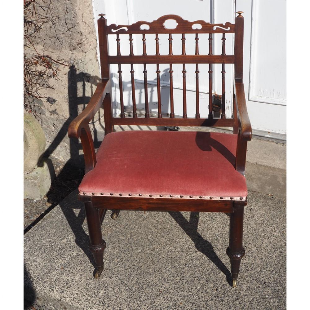 18th century walnut drunkards chair