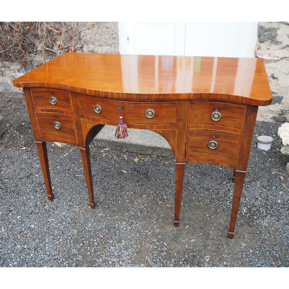 small george iii serpentine mahogany sideboard