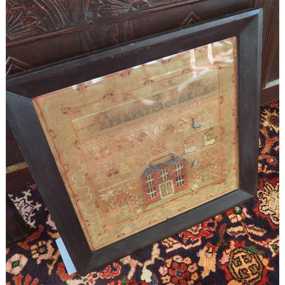 georgian framed sampler with house