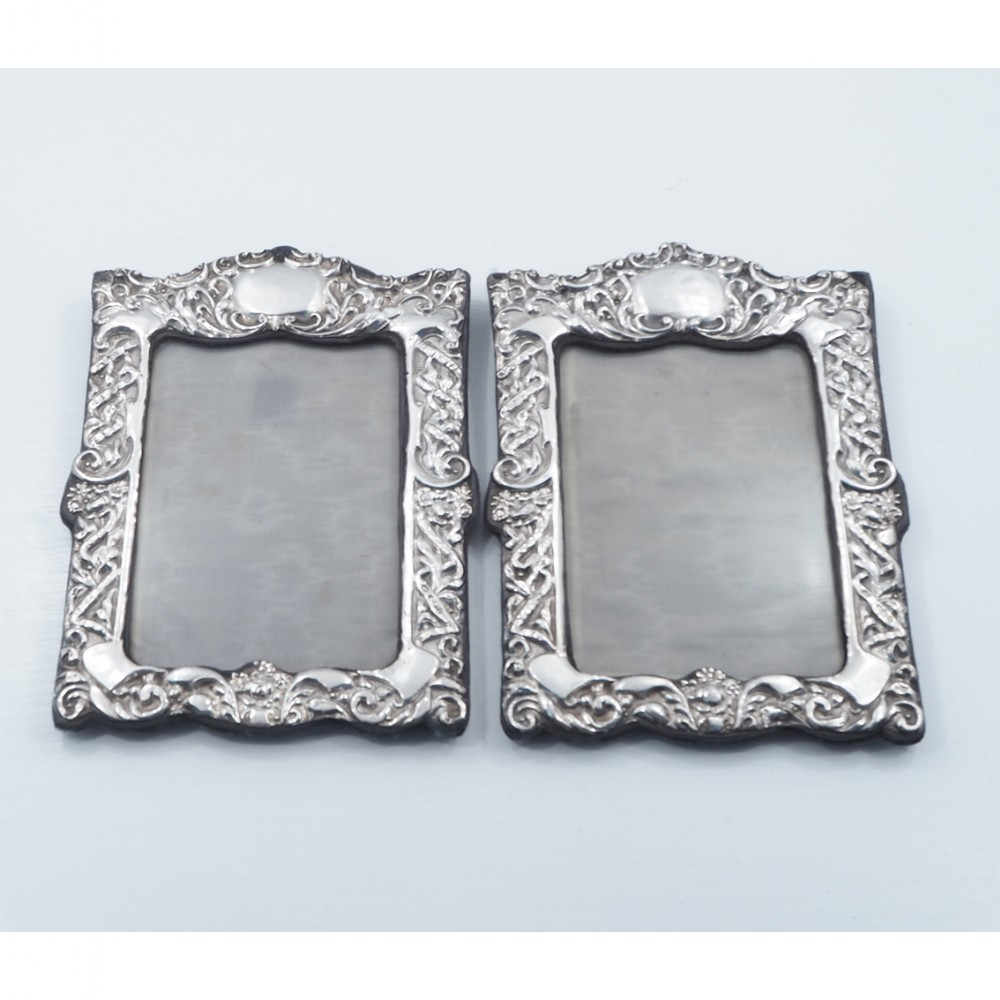 good pair of edwardian silver photo frames