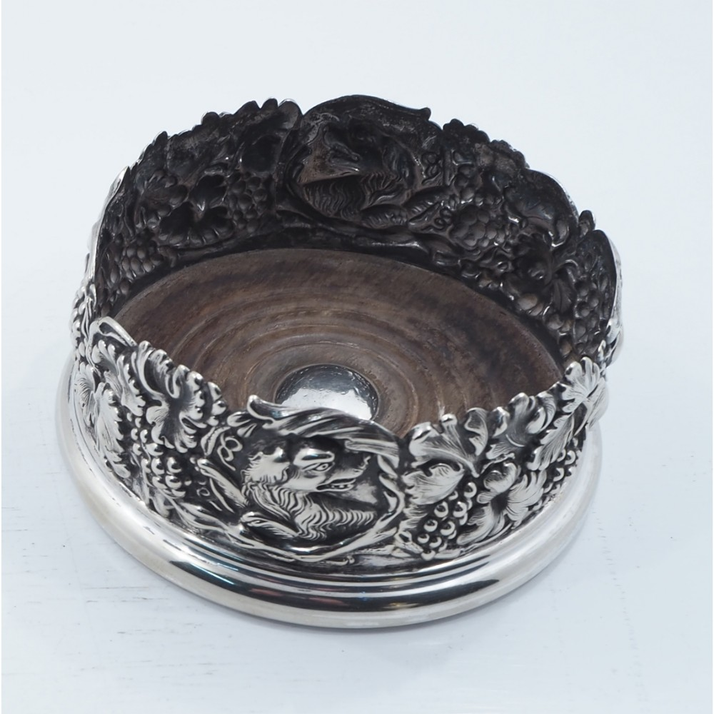 large silver plated coaster with dog