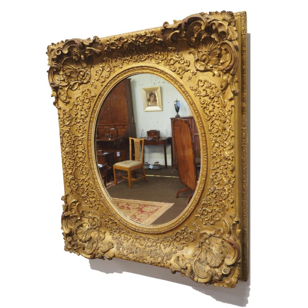 very decorative antique giltwood mirror
