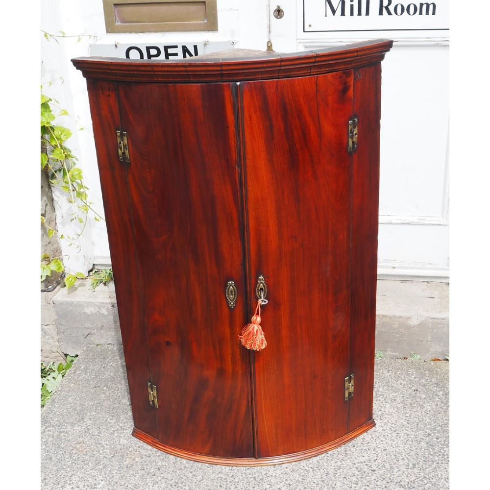 18th century mahogany bow corner cabinet
