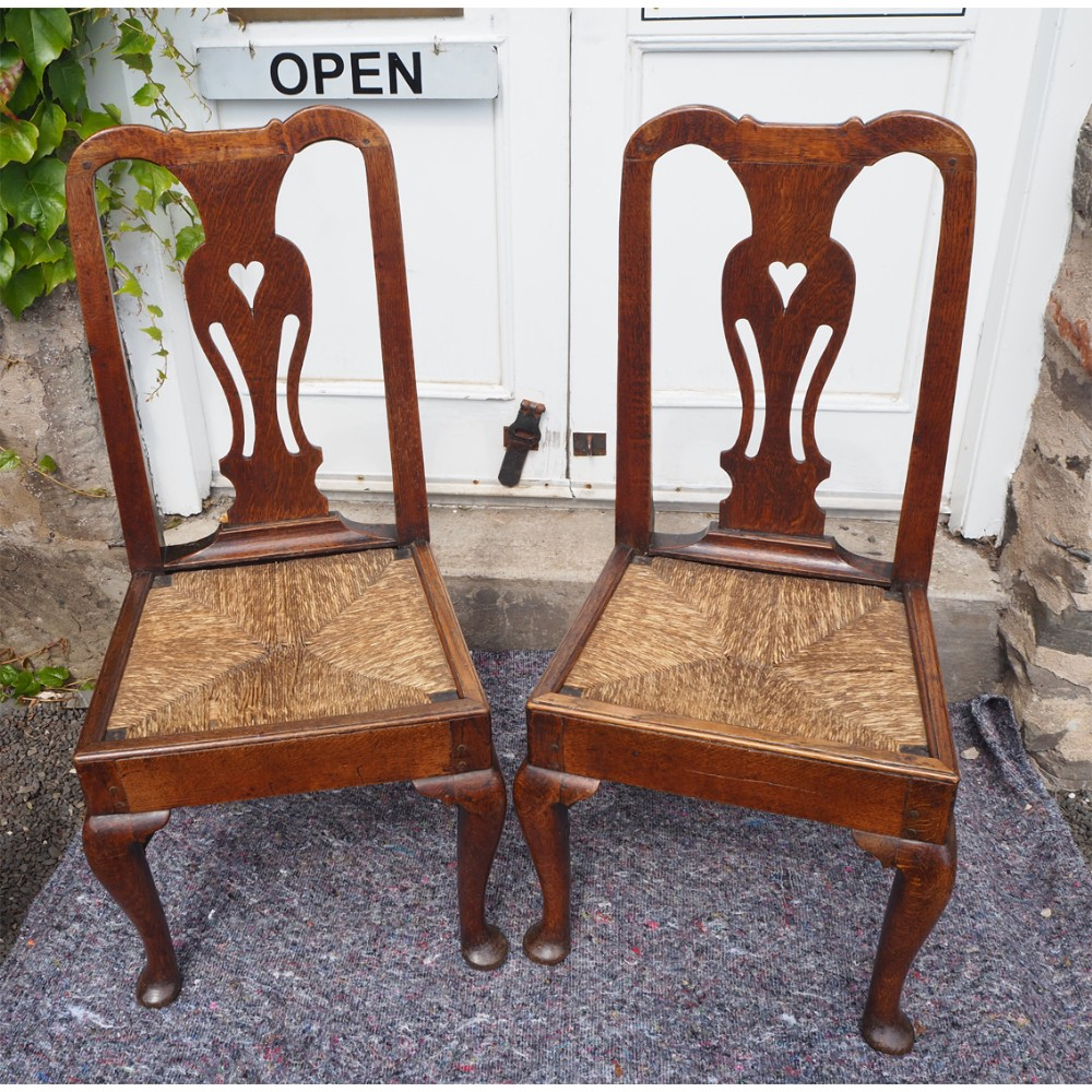 pair early georgian oak cab leg chairs