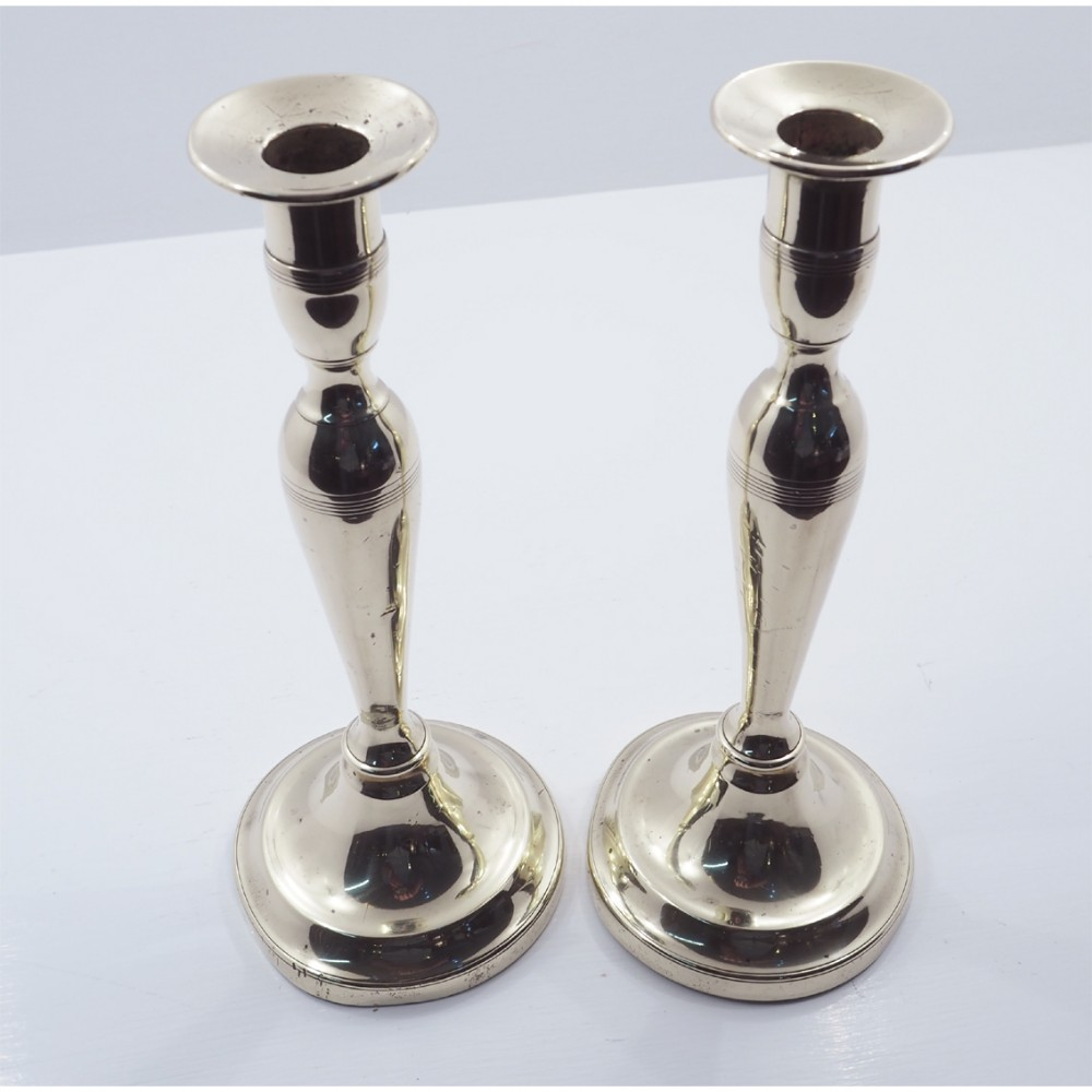 elegant pair of georgian brass candlesticks