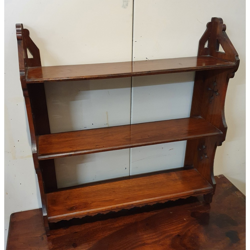 set of mahogany hanging wall shelves