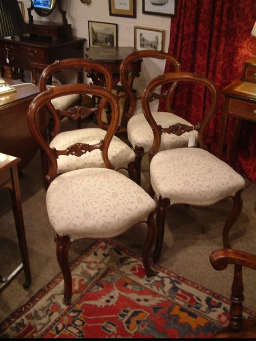 set of four walnut balloon back chairs c1850