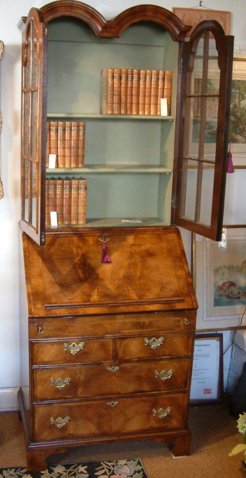 A Queen Anne Revival Walnut Bureau Bookcase