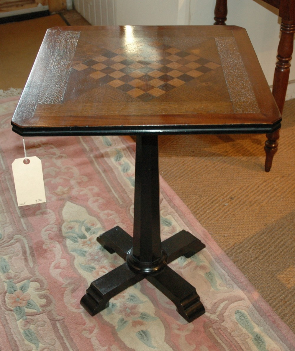 an oak and mahogany parquetry games table c1900