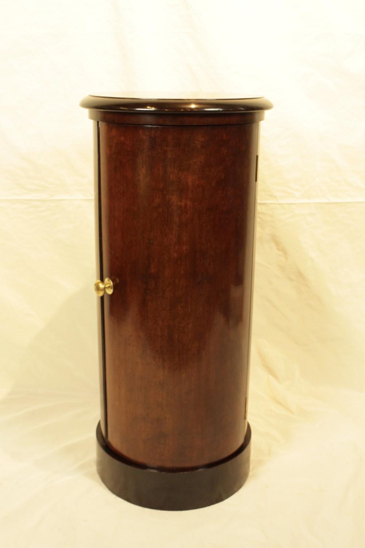 a mahogany plum pudding pot cupboard