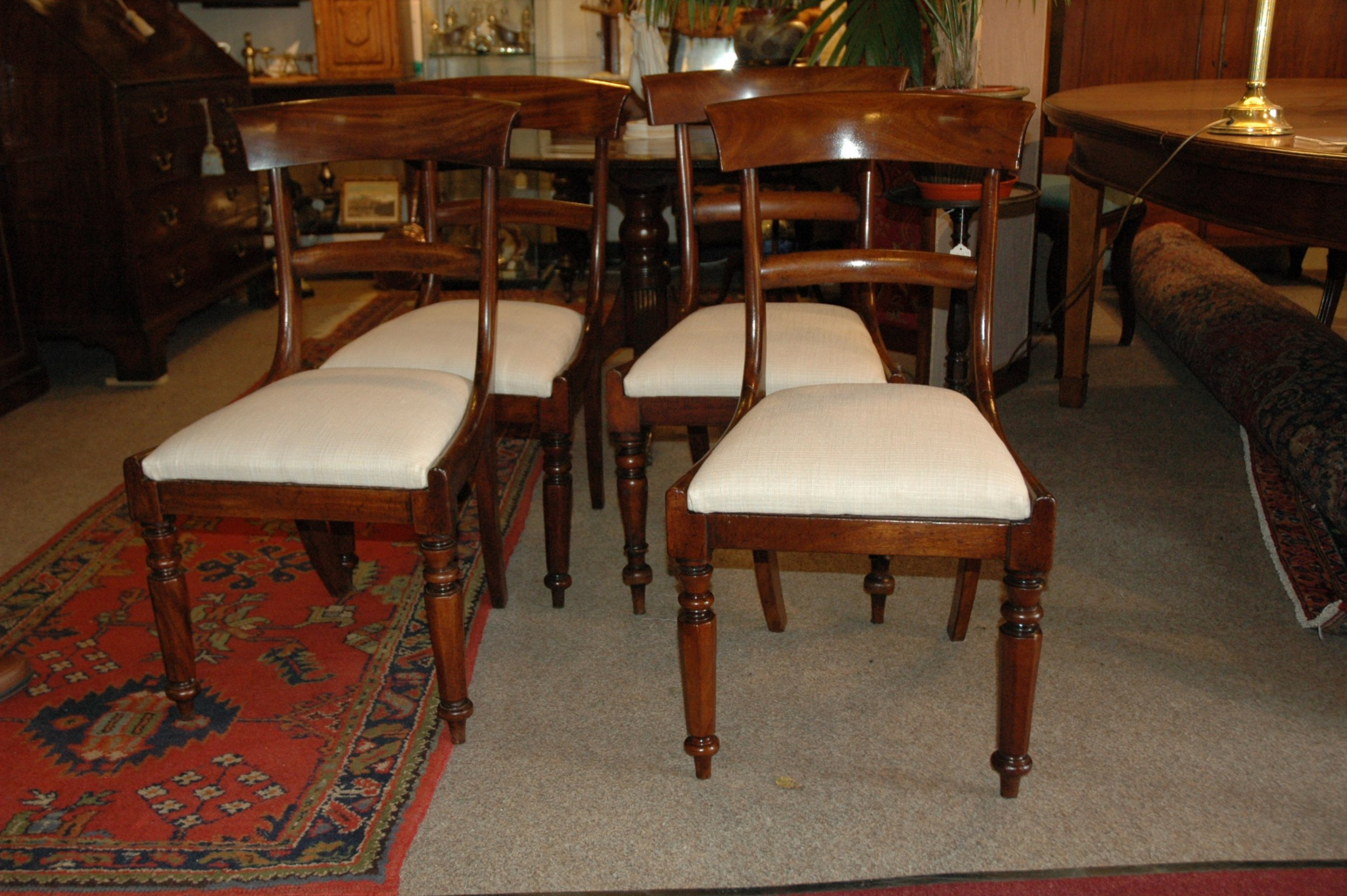 a harlequin set of four regency mahogany dining chairs