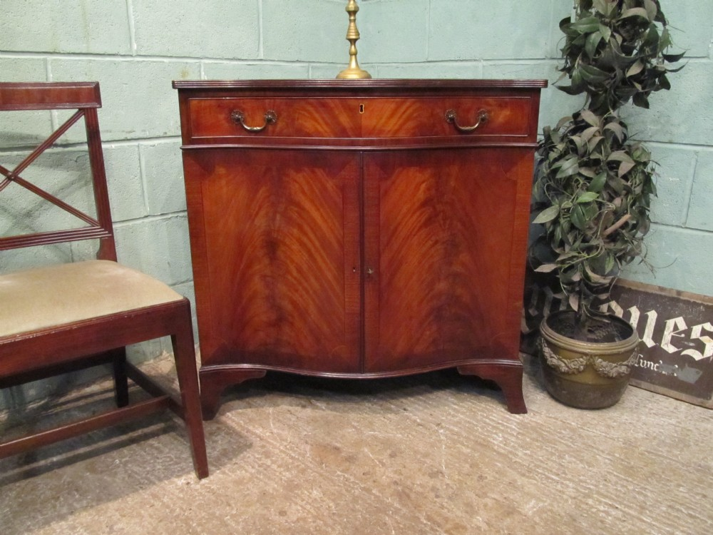 antique edwardian mahogany serpentine fronted cupboard c1900