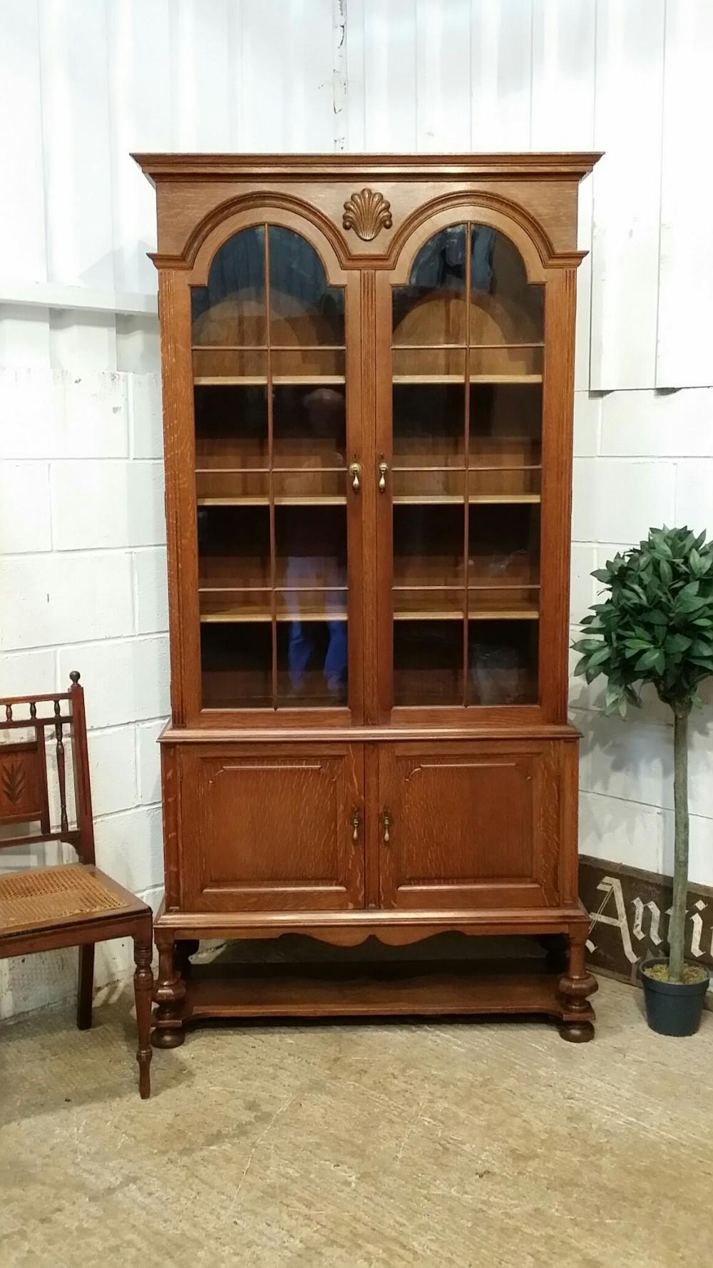 antique german tall glazed oak bookcase c1900
