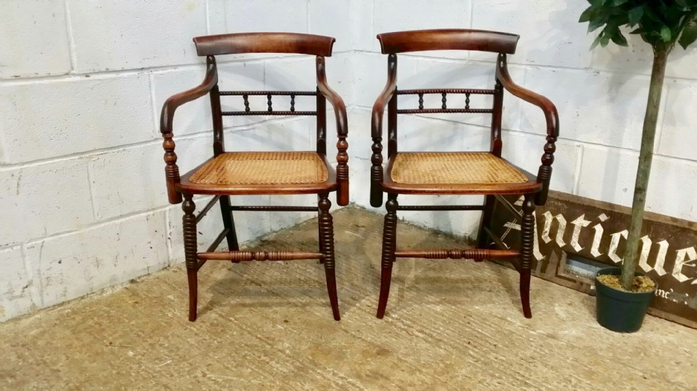 antique pair regency bergere elbow chairs c1820