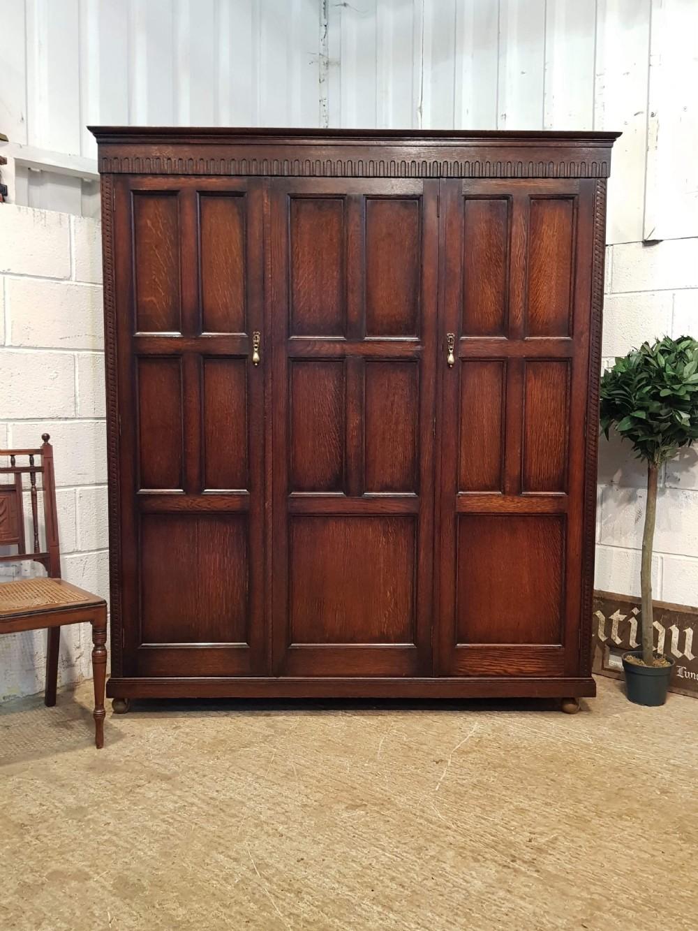 antique edwardian oak triple wardrobe by waring gillow c1900