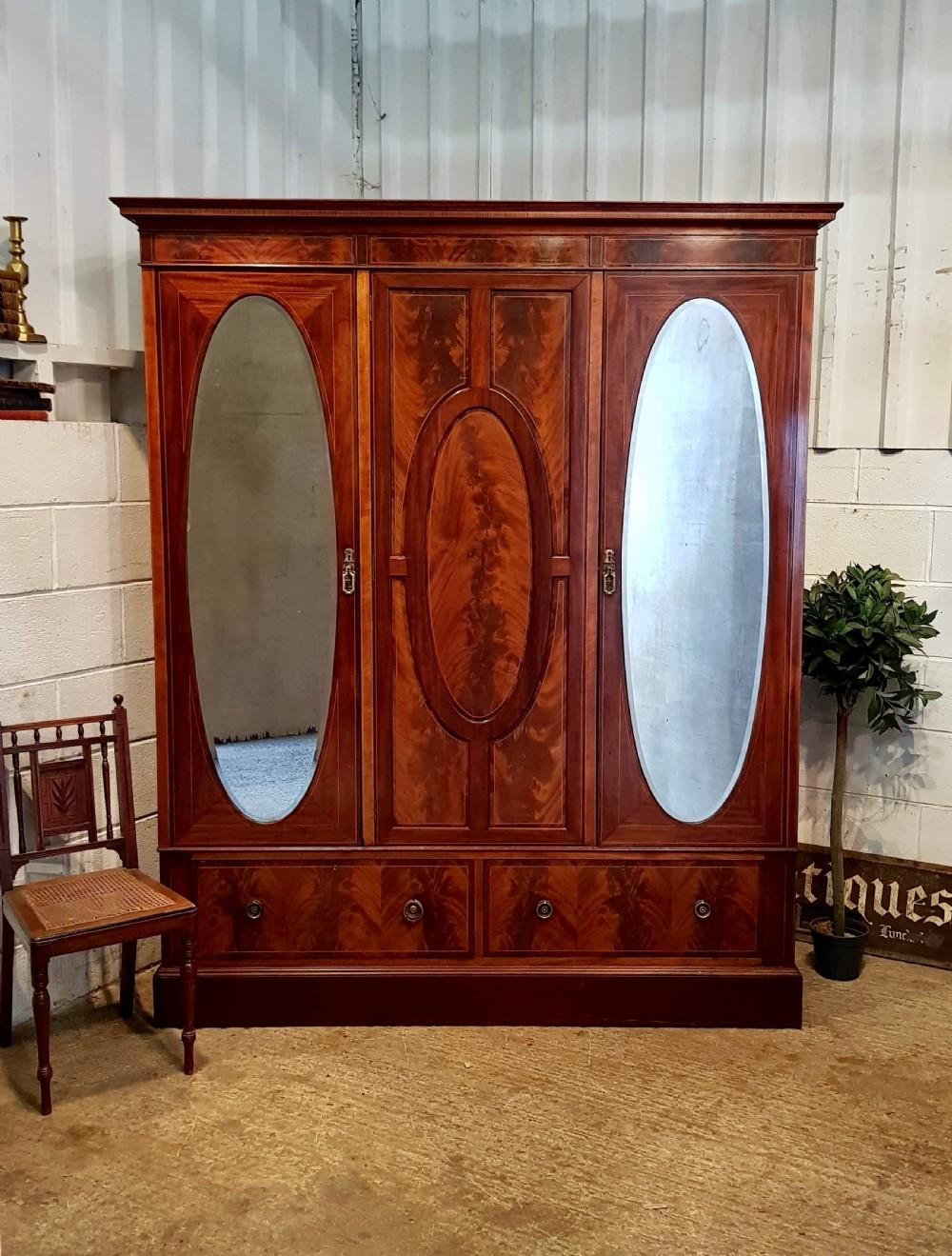 antique edwardian flamed mahogany triple wardrobe c1900