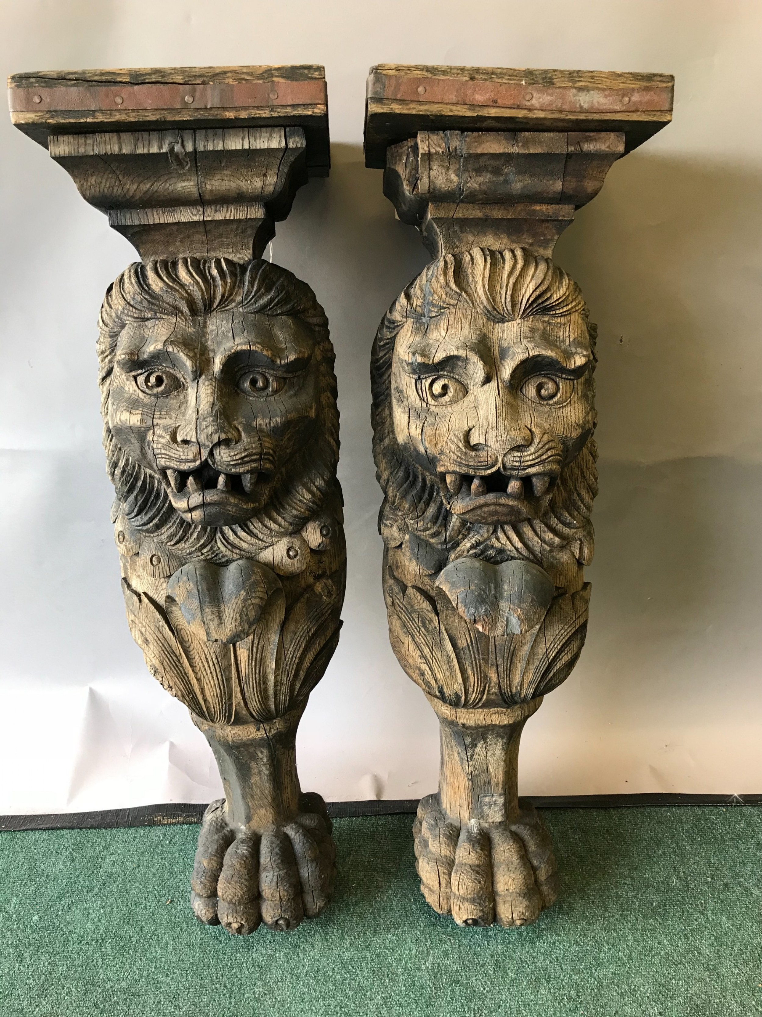 an impressive pair of 17th century carved oak heraldic lions