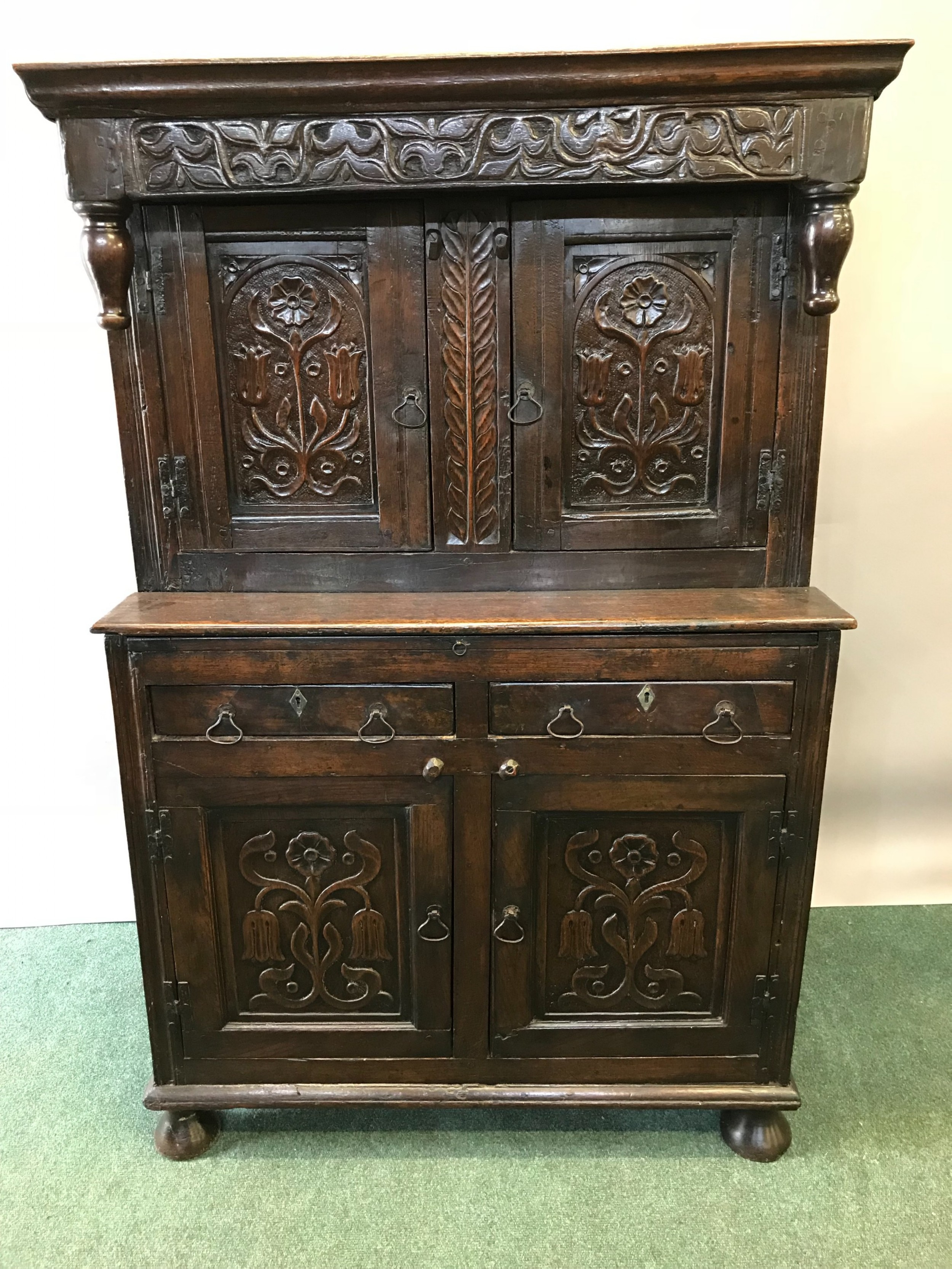 a small 17th century carved oak hall cupboard