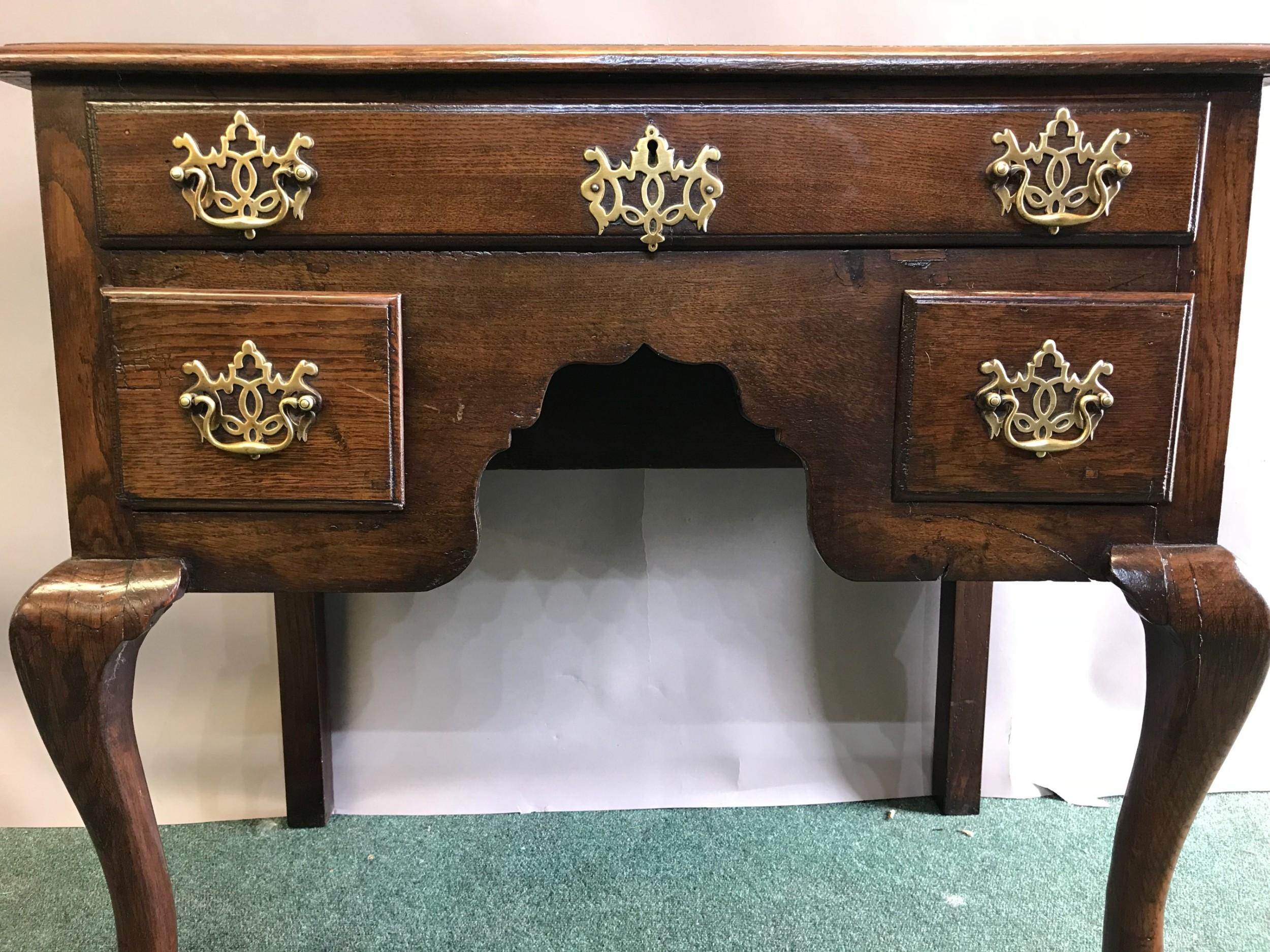 a good 18th century oak cabriole leg lowboy side table