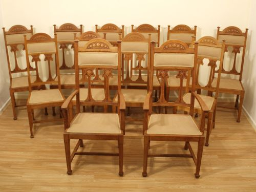 A set of 12 oak arts crafts period antique dining chairs for Arts and crafts dining room furniture