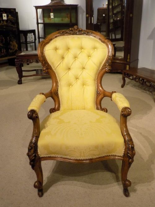 a good carved walnut victorian period antique armchair