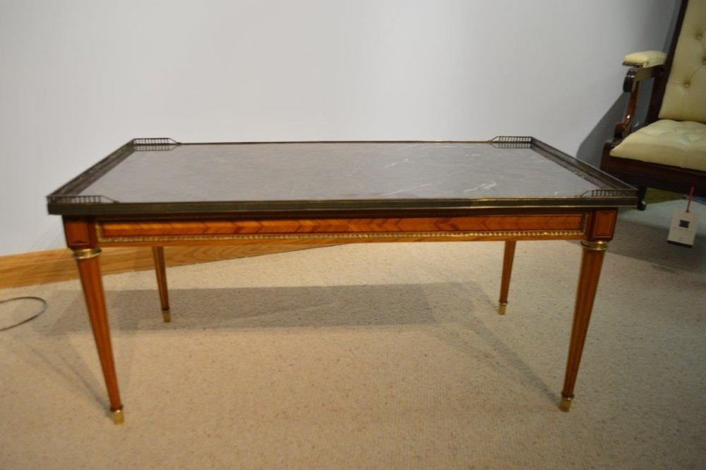 a 1920s french kingwood & mahogany marble top coffee table