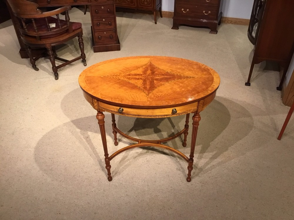 a satinwood edwardian period sheraton revival oval occasional table