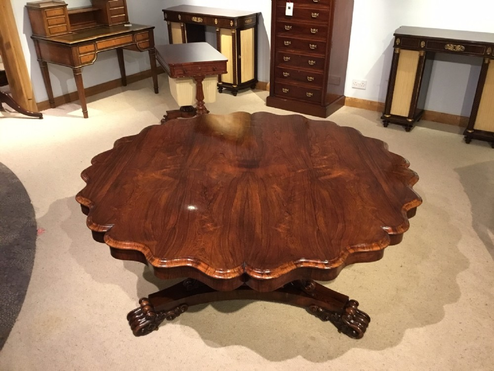 a fine quality rosewood william iv period scalloped dining table