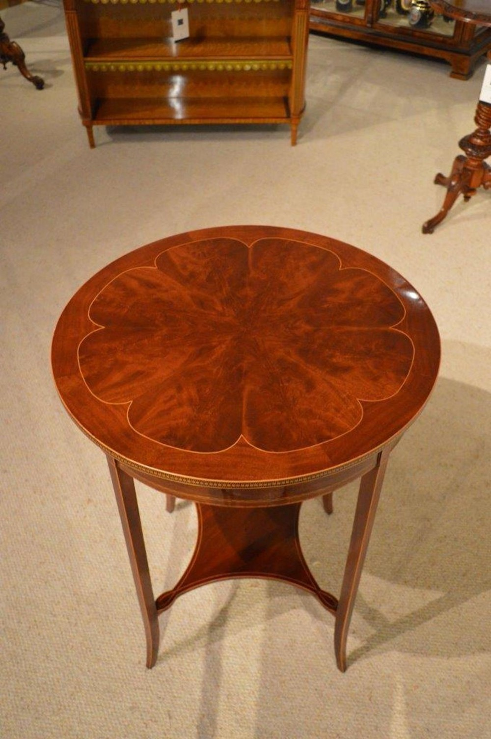 a fine quality flamed mahogany edwardian period circular occasional table
