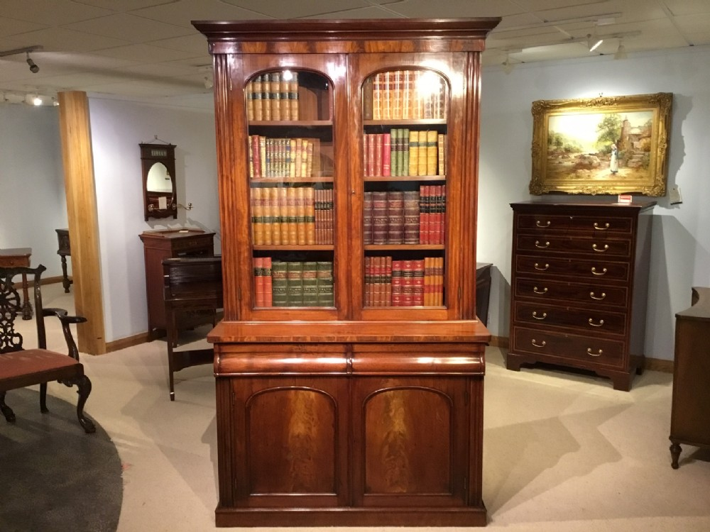 an early victorian period flame mahogany antique bookcase