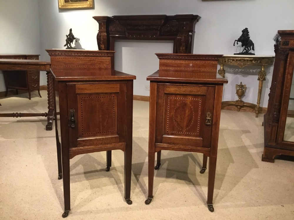a pair of mahogany inlaid edwardian period bedside cabinets
