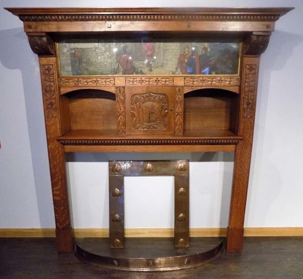a magnificent and rare arts crafts period oak fireplace probably by edgar wood