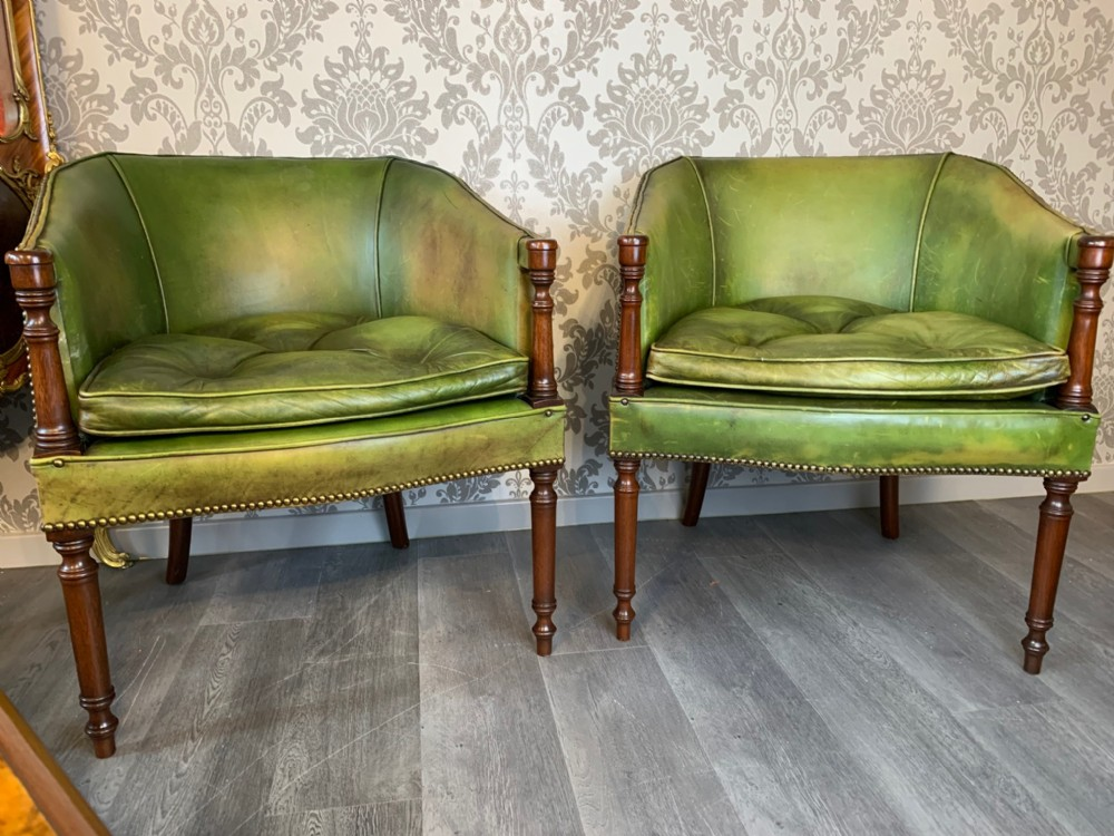 a fine quality pair of mahogany and green leather desk chairs