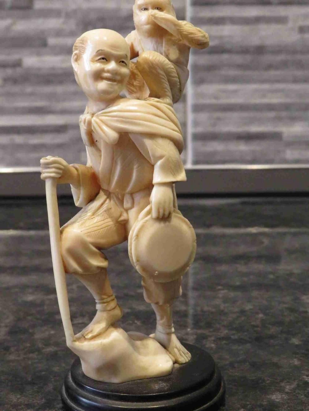 japanese carved okimono of a monkey trainer