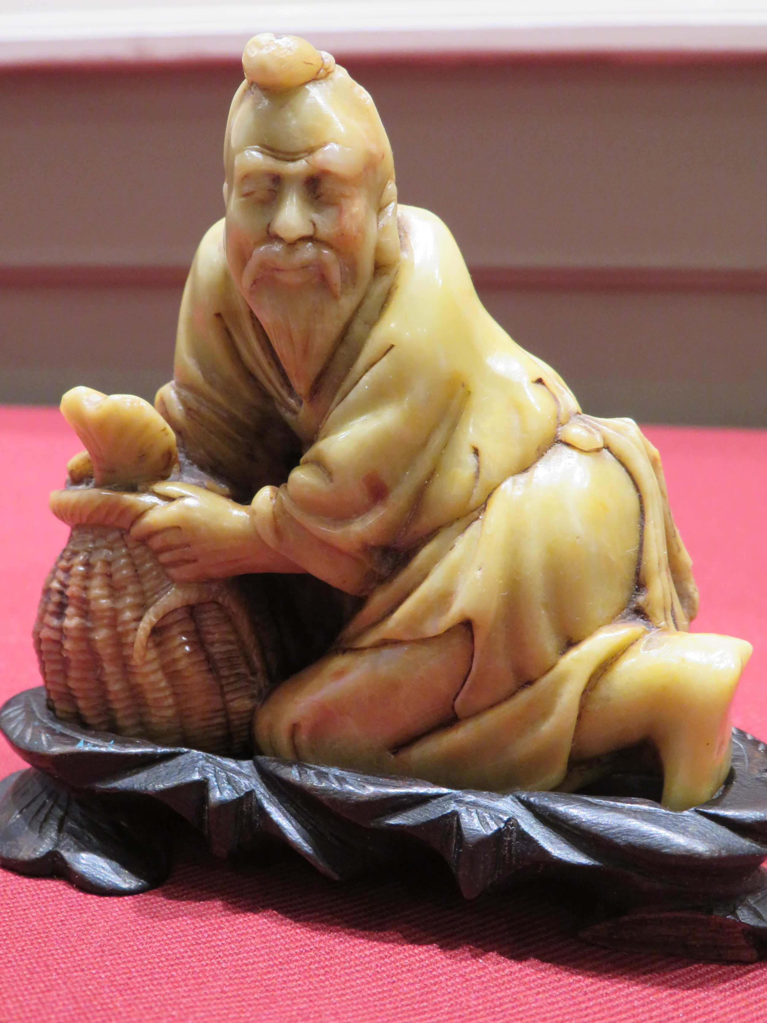 a chinese soapstone signed carving of a fisherman