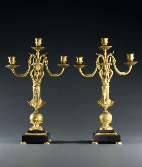pair of french empire style three branch candelabra of nike