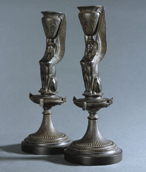 pair of egyptian revival bronzed sphinx candlesticks