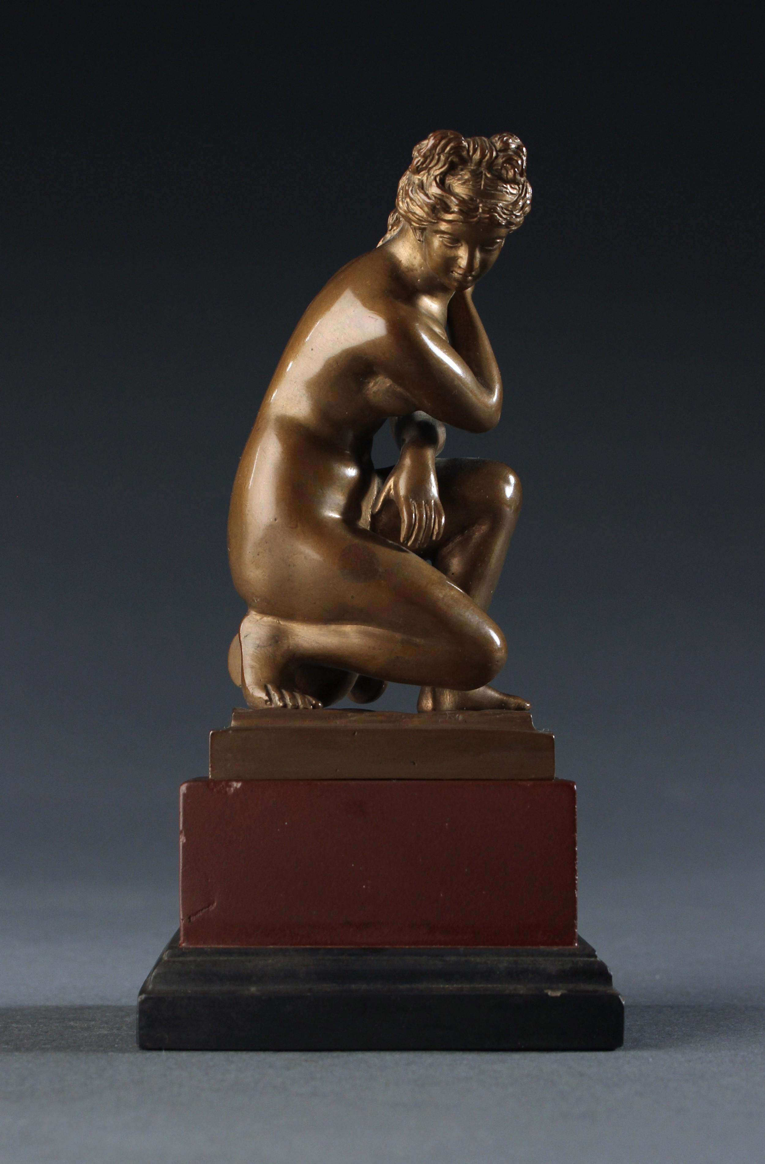 grand tour cabinet bronze of crouching venus