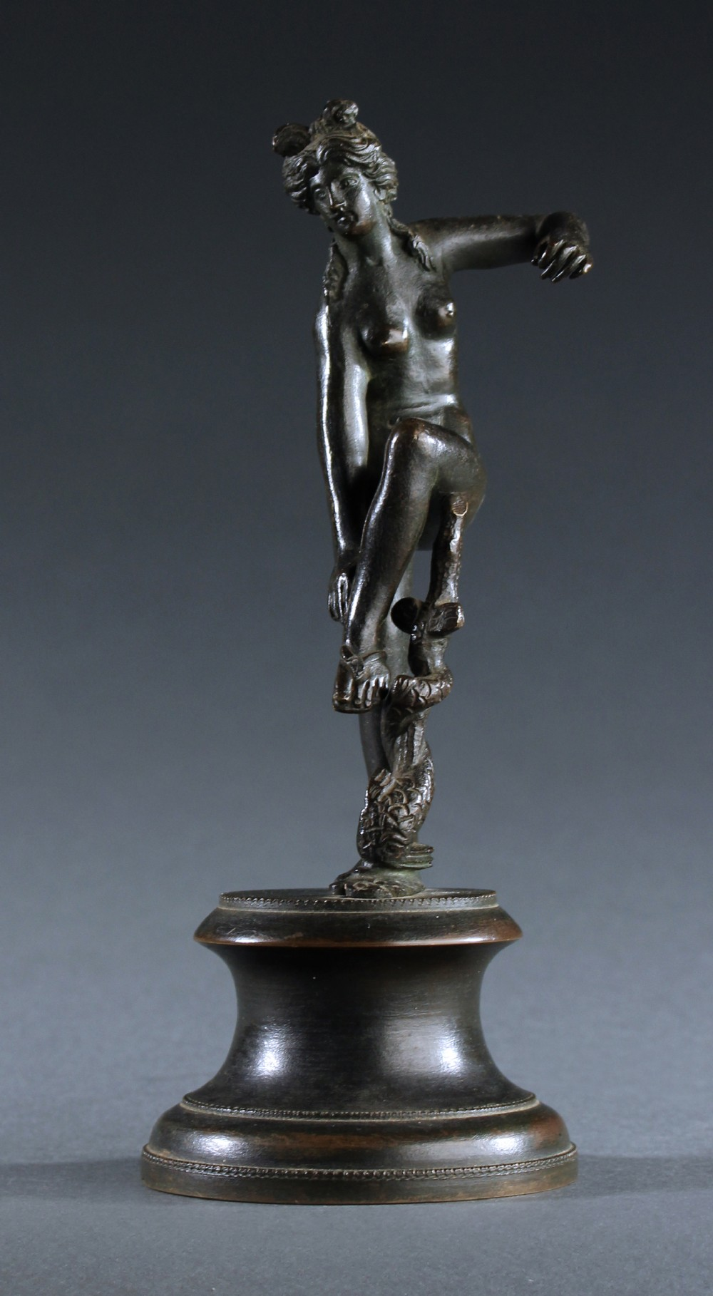 grand tour bronze figure of aphrodite untying her sandal