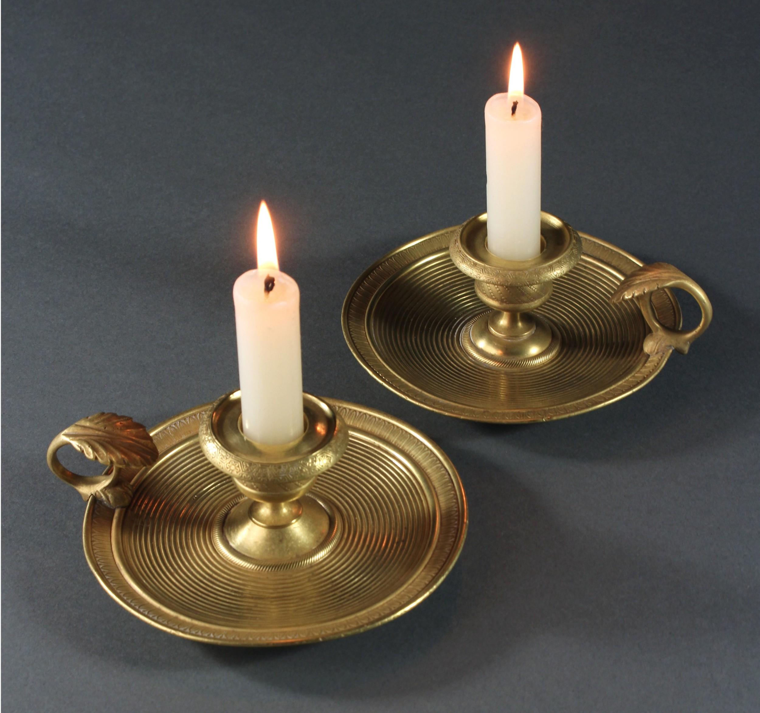 pair of french empire gilt bronze chamber sticks