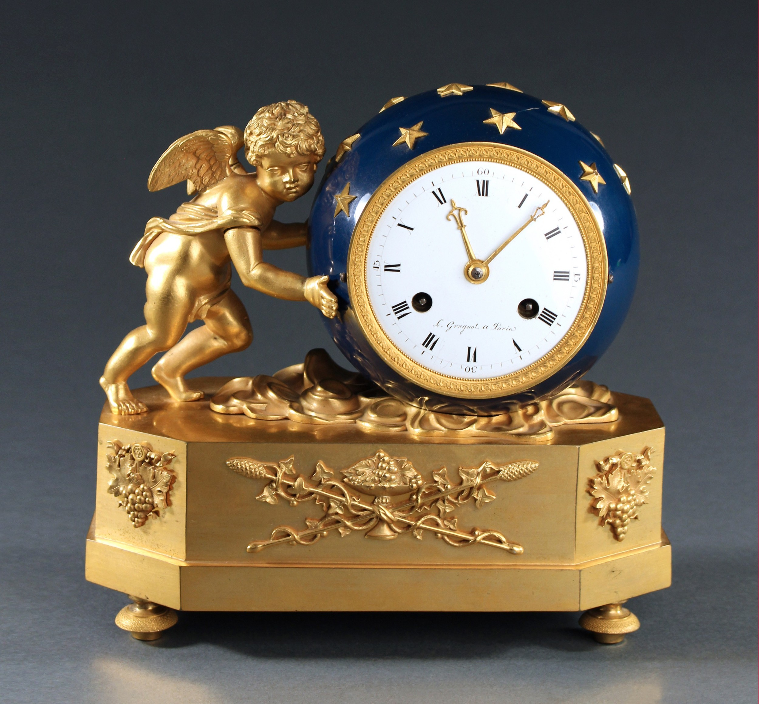 fine french empire clock depicting love moving the heavens