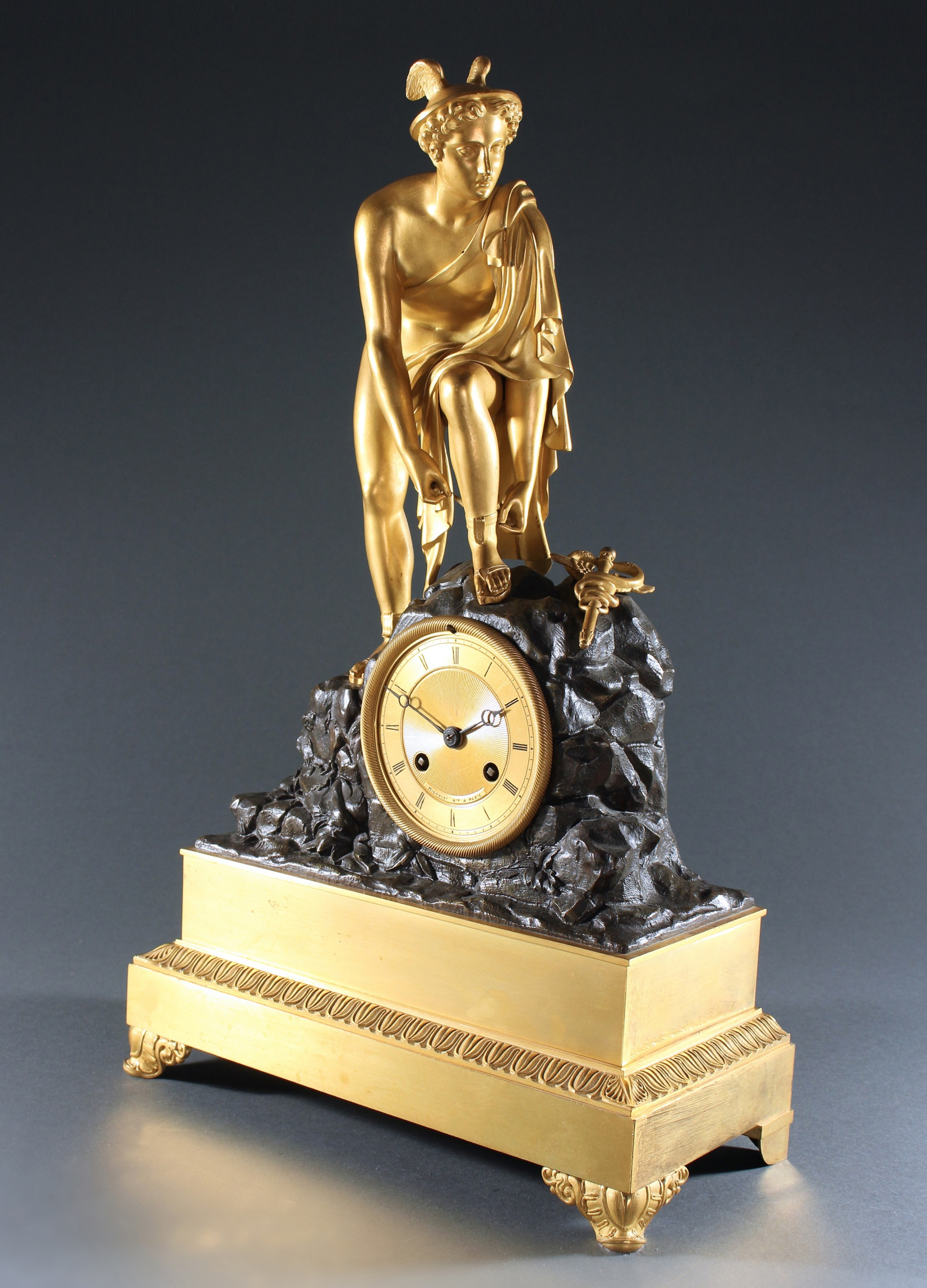 french empire gilt and patinated bronze hermes clock