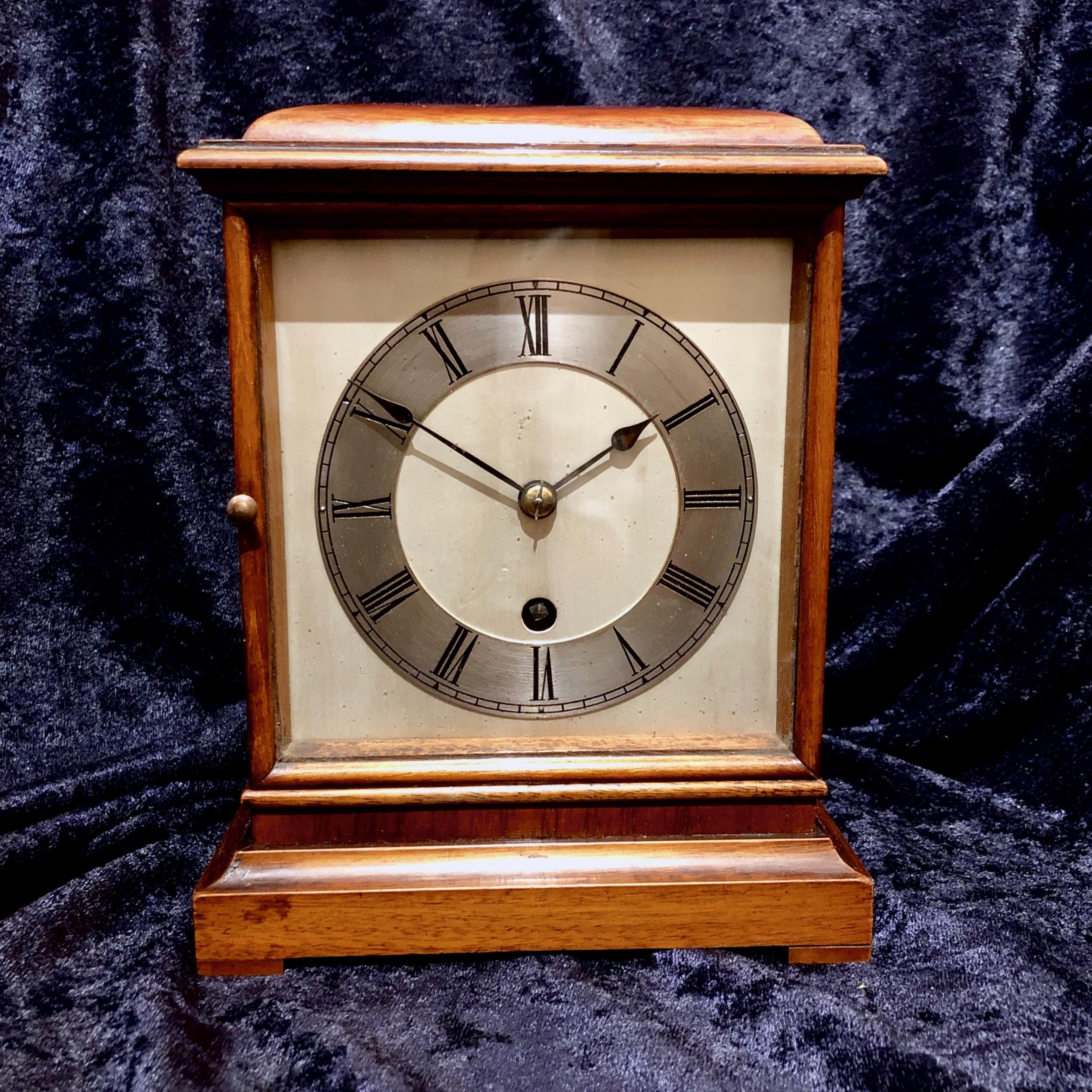 an early 20th century mahogany mantel clock