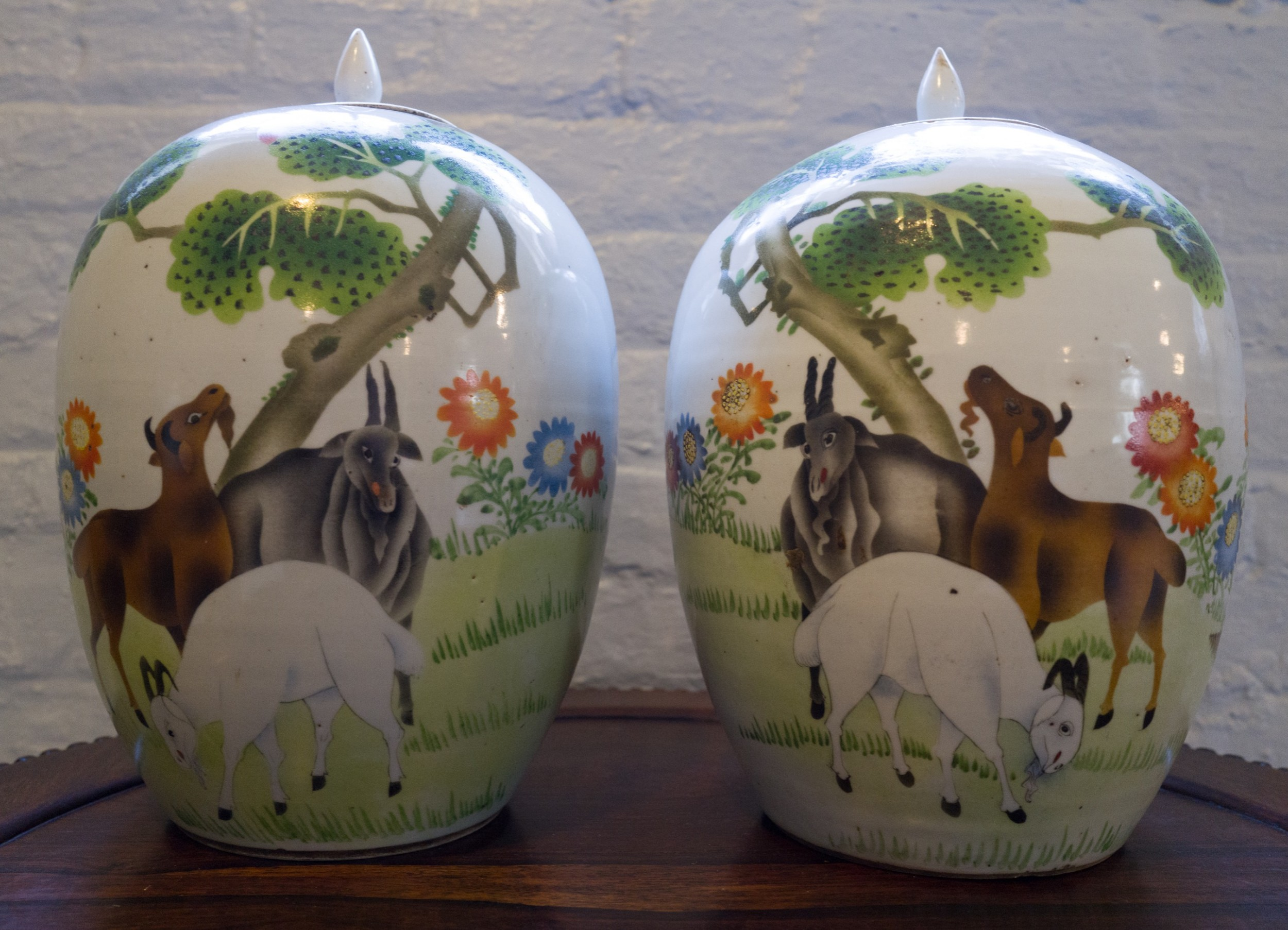 pair of unusual chinese jars lids decorated with goats