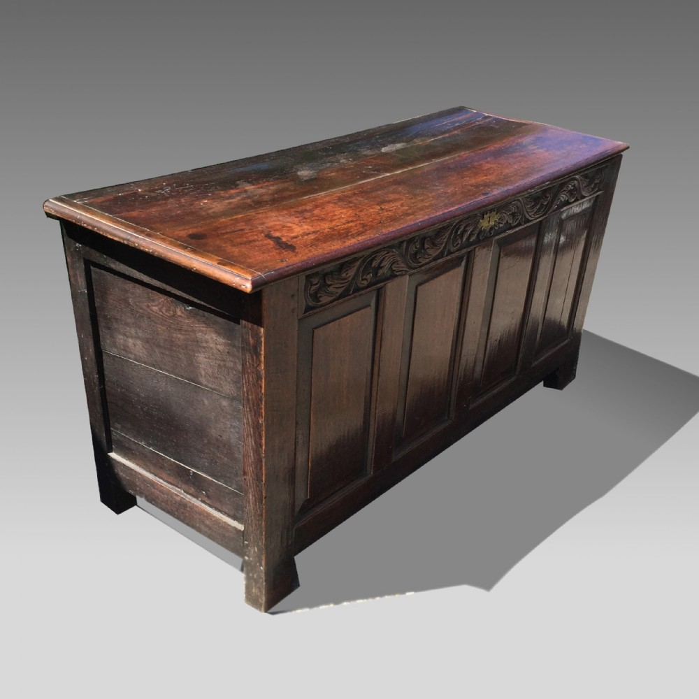 large 17th century oak coffer with carved front and good colour