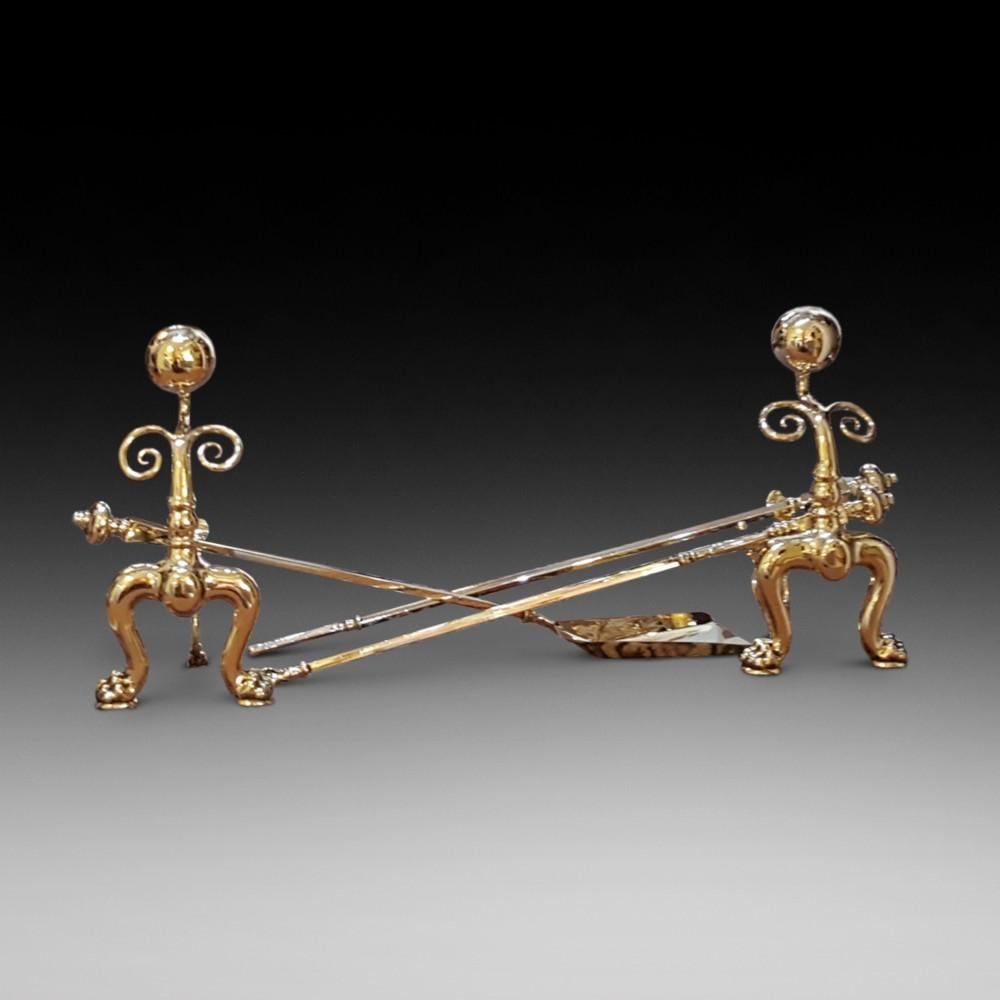 a good pair of victorian brass fire dogs