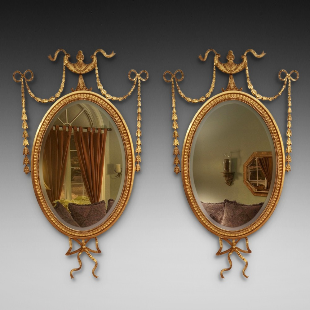 pair of edwardian adam revival carved gilt wood and gesso wall mirrors
