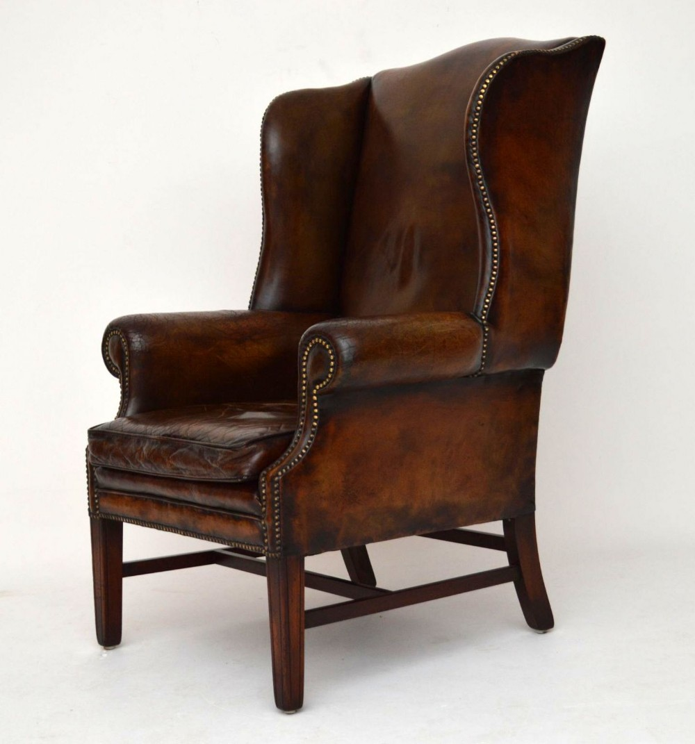 Antique distressed leather wing back armchair 288998 for Armchair with high back