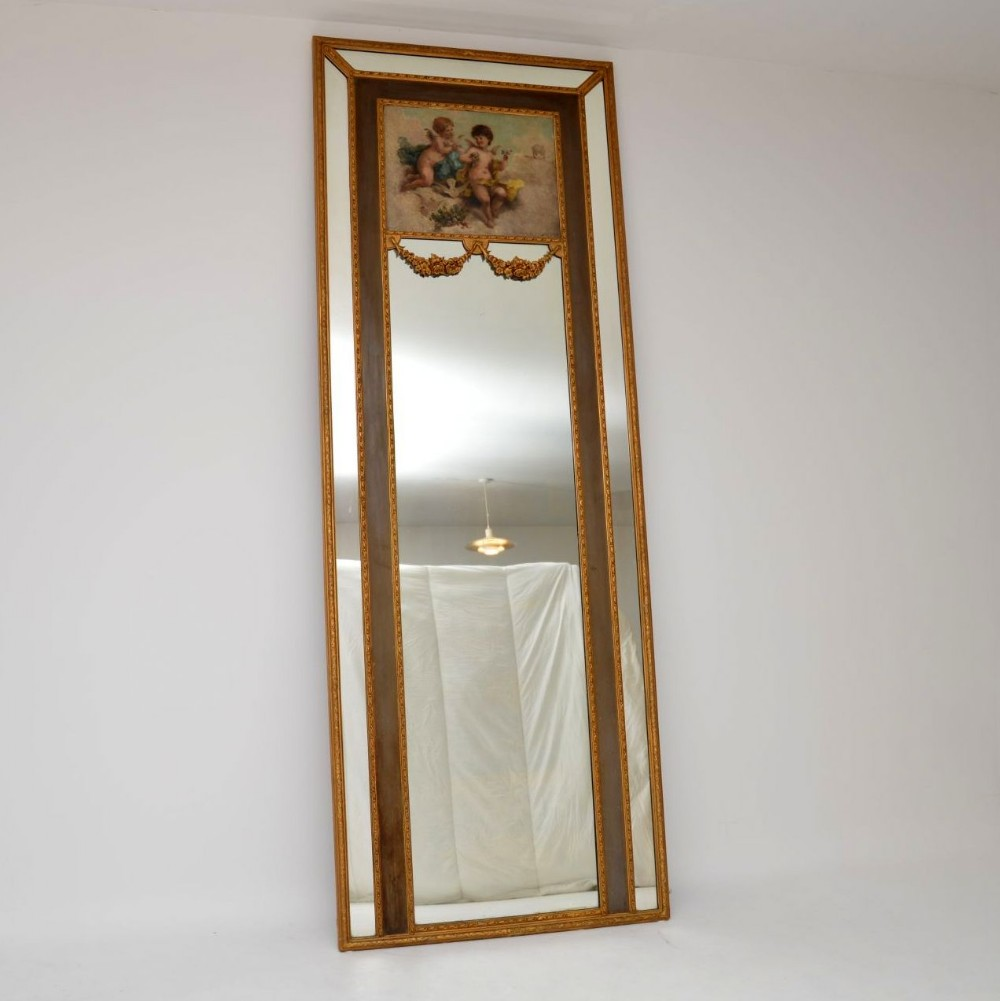 very tall antique gilt wood mirror with oil painting