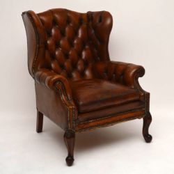 LARGE ANTIQUE LEATHER WING BACK ARMCHAIR. £1,450. Dated 1890